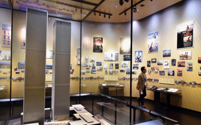 A model of the World Trade Center buildings, seen during a press preview in the National September 11 Memorial Museum at the World Trade Center site on 14 May 2014 in New York. Picture:AFP.