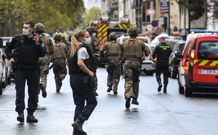 French army soldiers rush to the scene after several people were injured near the former offices of the French satirical magazine 'Charlie Hebdo' following an alleged attack by a man wielding a knife in the capital Paris on 25 September 2020. Picture: AFP.