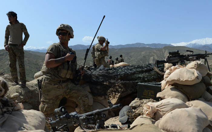 FILE: In this photograph taken on 11 April 2017, US soldiers take up positions during an ongoing an operation against Islamic State militants in the Achin district of Afghanistan's Nangarhar province. Picture: AFP