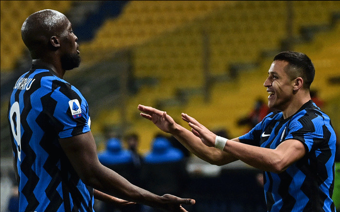 Inter Milan's Chilean forward Alexis Sanchez celebrates with Inter Milan's Belgian forward Romelu Lukaku (L) after scoring his second goal during the Italian Serie A football match Parma vs Inter Milan on March 04, 2021 at the Ennio-Tardini stadium in Parma. Picture: Miguel Medina / AFP.