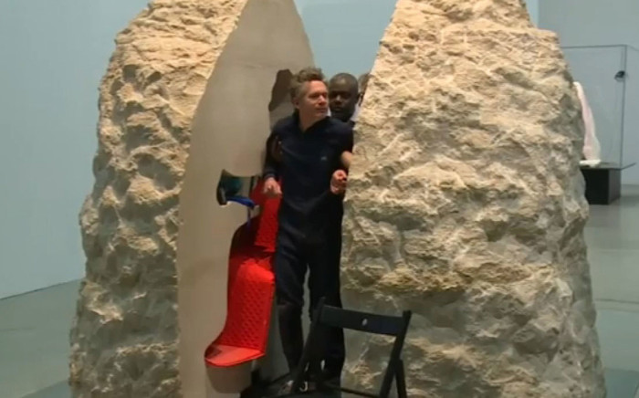 A screengrab shows French artist Abraham Poincheval, who spent seven days inside a block of stone in a Paris museum. Picture: youtube.com