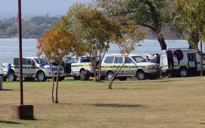 Police divers on the shore of Hartbeespoort Dam conducting a search for missing toddler who fell out of a capsized boat on 11 May 2015. Picture: Louise McAuliffe/EWN.