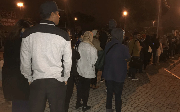 Scores of stranded commuters wait in long queues as they find alternative means to get to work following the national bus strike. Picture: EWN