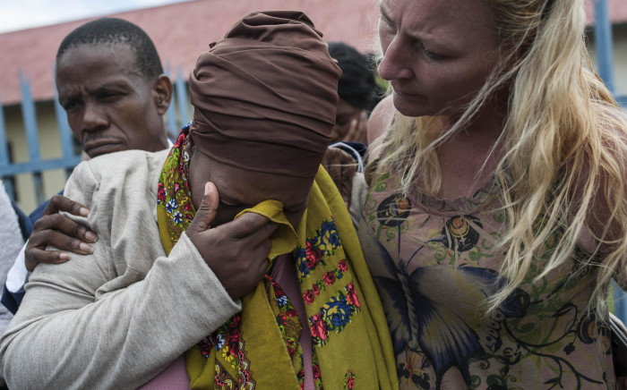 FILE: Latoya Gwam's mother, Nontombi, is seen weeping outside the Alberton Police Station. Picture: Ihsaan Haffejee/EWN.