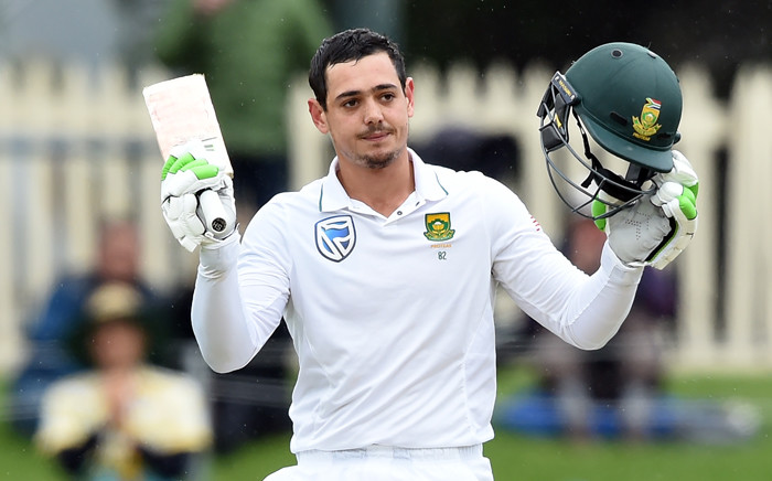 South Africa's batsman Quinton de Kock celebrates his 100-runs on the third day's play of the second Test cricket match between Australia and South Africa in Hobart remained on 14 November, 2016. Picture: AFP.