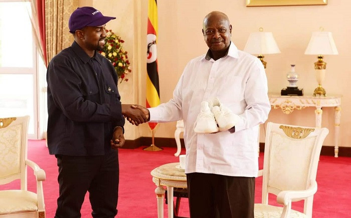 Kanye West gifts President of Uganda Yoweri Museveni with a pair of signed white sneakers. Picture: Twitter/@KagutaMuseveni.