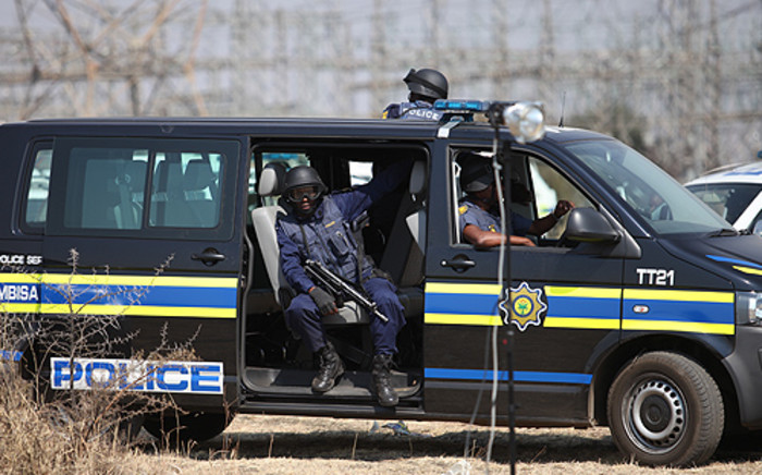 FILE: Members of the police's tactical response team on standby at Lonmin's Marikana Mine. Picture: Taurai Maduna/EWN.