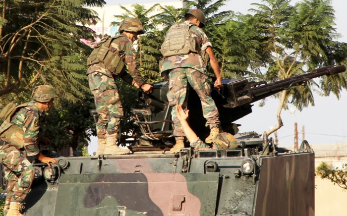 FILE: Lebanese army soldiers on their armored vehicle near the area of clashes with Sunni militants, Tripoli, Lebanon, 26 October 2014. Picture: EPA.