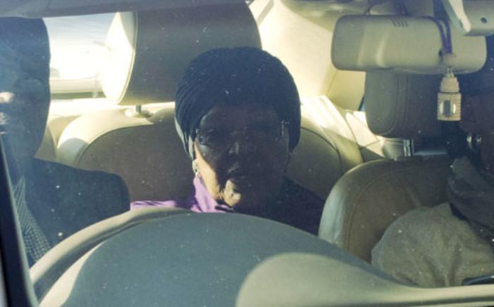 Winnie Madikizela-Mandela (C) arrives on June 10, 2013 at a Pretoria hospital, where her ex-husband, former South African President Nelson Mandela has been hospitalised as a result of recurring lung infection.. AFP PHOTO / ALEXANDER JOE