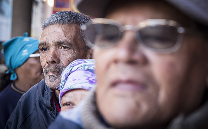 Pensioners queue outside of a supermarket in Mitchells Plain on the 1st of the month to collect their SASSA grants. Picture: Thomas Holder/EWN