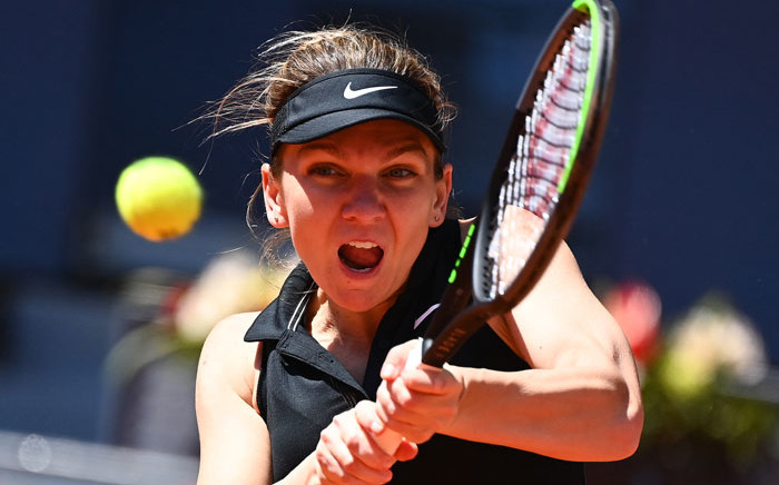Romania's Simona Halep returns the ball to Belgium's Elise Mertens during their 2021 WTA Tour Madrid Open tennis tournament singles match at the Caja Magica in Madrid on 4 May 2021. Picture: Gabriel Bouys/AFP