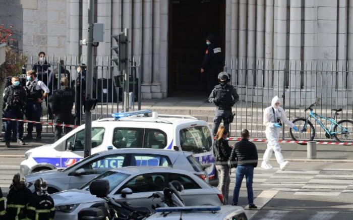 French members of the elite tactical police unit RAID enter to search the Basilica of Notre-Dame de Nice after a knife attack in Nice on October 29, 2020. Picture: AFP