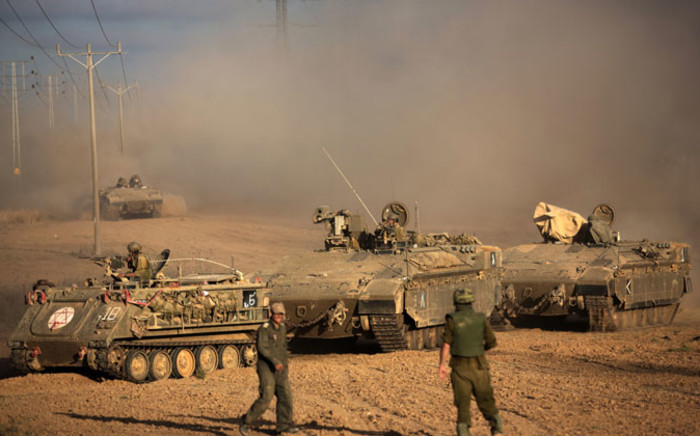 FILE: A convoy of Israeli armoured personnel carriers (APC) move towards the Israeli-Gaza border on 18 July 2014. Picture: AFP.