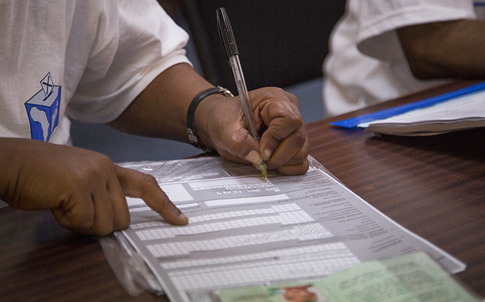 FILE: An IEC official registers a first time voter on 6 March 2016. Picture: Aletta Harrison/EWN.