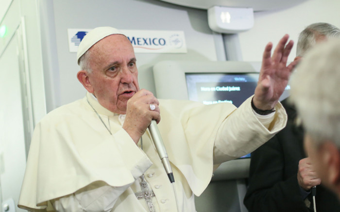 FILE: A handout picture provided by Presidency of Mexico on 18 February 2016 shows Pope Francis waving during his farewell ceremony in Ciudad Juarez. Picture: AFP.