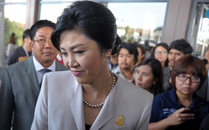 FILE: Former Thai Prime Minister Yingluck Shinawatra is surrounded by media at the Army Club in Bangkok on 10 December, 2013. Picture: AFP