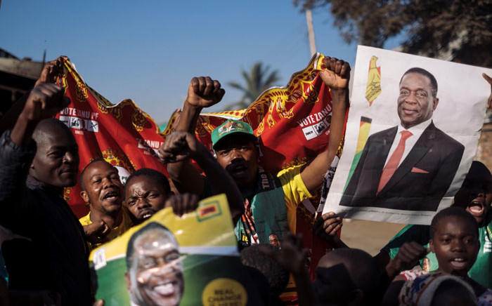 Supporters of Emmerson Mnangagwa celebrate his election victory. Picture: AFP