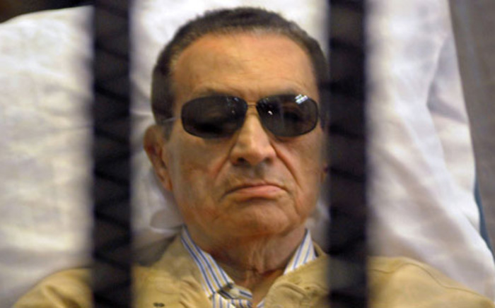 Ousted Egyptian president Hosni Mubarak sits inside a cage in a courtroom during his verdict hearing in Cairo on June 2, 2012. Picture: AFP