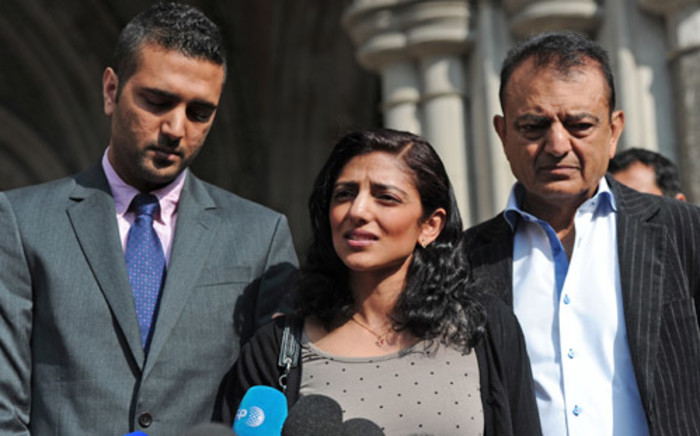Sister of killed newlywed Anni Dewani, Ami Denborg (C) flanked by brother Anish Hindocha (L) and father Vinod Hindocha (R) outside the High Court in central London. Picture: AFP