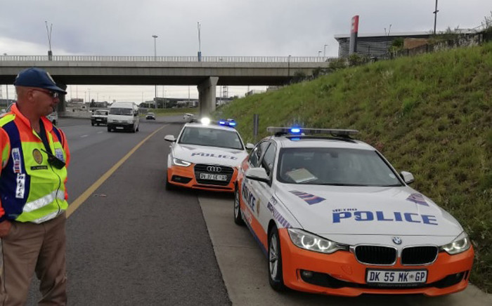 FILE: A JMPD officer conducts a roadside check in Johannesburg. Picture: @AsktheChiefJMPD/Twitter