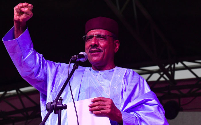 Niger's newly elected president Mohamed Bazoum gestures as he delivers a speech at his party headquarter after the announcement of his election in Niamey, on 23 February 2021. Picture: Issouf SANOGO / AFP.