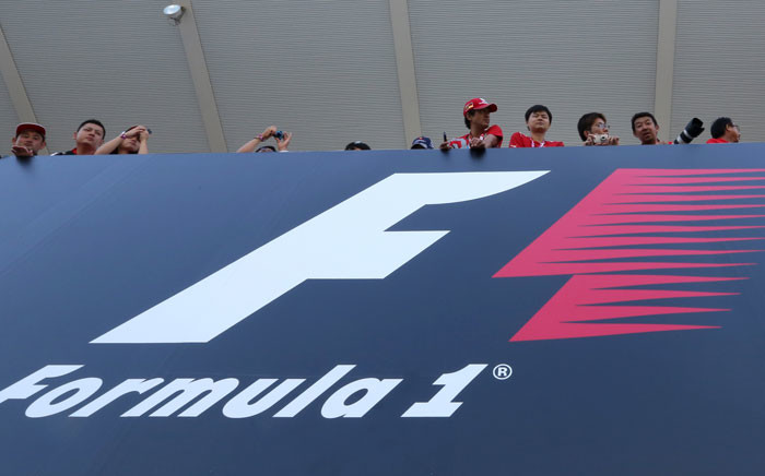 FILE: Fans looks over the circuit above a board reading Formula 1 during the second practice session at the Formula One Japanese Grand Prix in Suzuka. Picture: AFP