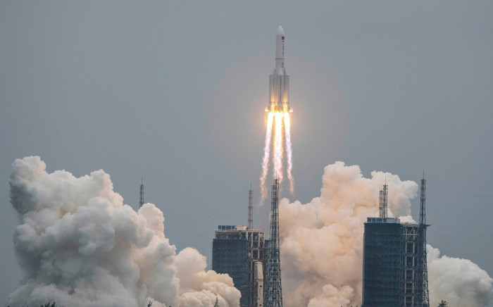 A file image taken on April 29, 2021 shows a Long March 5B rocketlifting off from the Wenchang Space Launch Center in southern China's Hainan province. A large segment of the Long March 5B rocket re-entered the Earth's atmosphere and disintegrated over the Indian Ocean. Picture: AFP