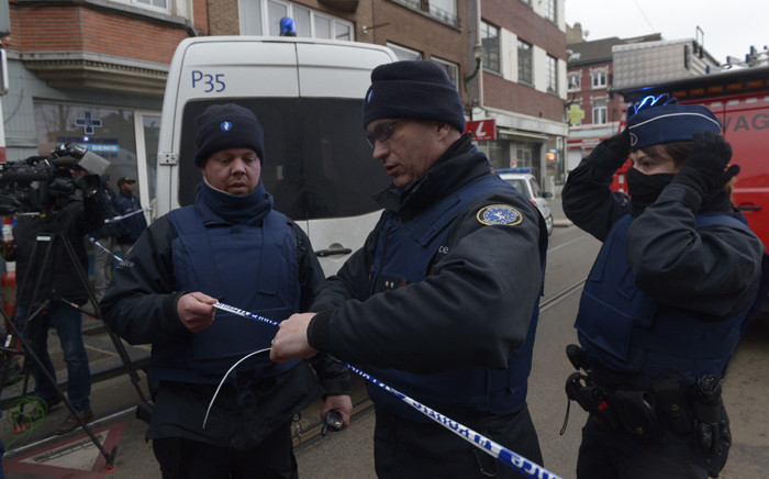 Police officers set a security perimeter near the site where shots were fired at Belgian police, on March 15, 2016 in Brussels. The shots were fired as Belgian police carried out an operation linked to the Paris attacks, as Belgian police continue their hunt for Salah Abdeslam, a key suspect in the November attacks which killed 130 people, who comes from Brussels. Picture: AFP.