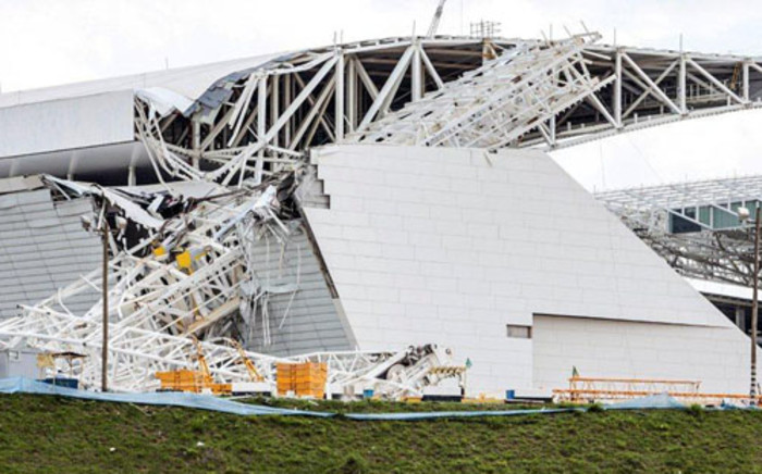 Damages at the Arena de Sao Paulo stadium, where the opening match of the 2014 FIFA World Cup is to be hosted, after a crane fell across part of the metallic structure, on November 27, 2013 in Sao Paulo. Picture: AFP/ Miguel Schincariol.