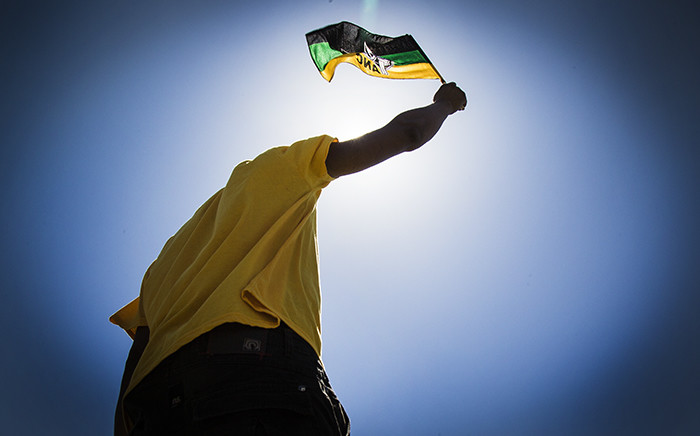 FILE: An ANC supporter waves his party's colours at the 104 years celebration in Grabouw. Picture: Thomas Holder/EWN