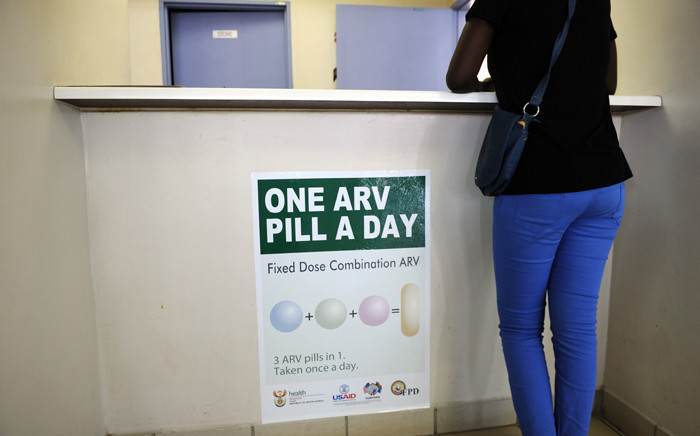 FILE: A woman queues at Phedisong clinic on 8 April, 2013 during the launch of the new single dose anti-AIDs drug in Ga-Rankuwa, 100 kms north of Johannesburg. Picture: AFP.