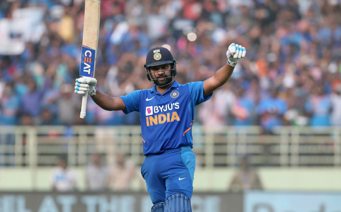India's Rohit Sharma celebrates his century (100 runs) during the second one day international (ODI) cricket match between India and the West Indies in Visakhapatnam on 18 December 2019. Picture: AFP