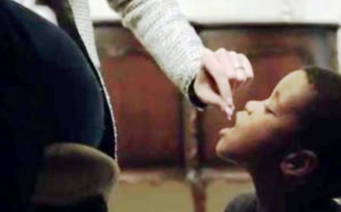 A screenshot of the Feed a Child advert depicting a black child as a dog.