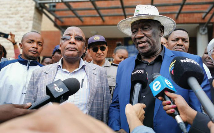 Home Affairs Minister Aaron Motsoaledi alongside Police Minister Bheki Cele in Diepsloot following a meeting with residents who have been protesting against crime and undocumented foreigners in their community. Picture: Dept Home Affairs/Twitter