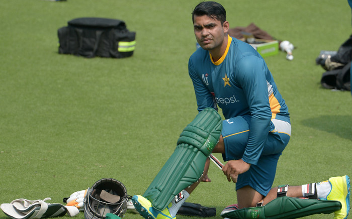 FILE: Pakistan's Umar Akmal pads up he takes part in a training session ahead of the World T20 cricket tournament match at The Eden Gardens Cricket Stadium in Kolkata on 13 March 2016. Picture: AFP.