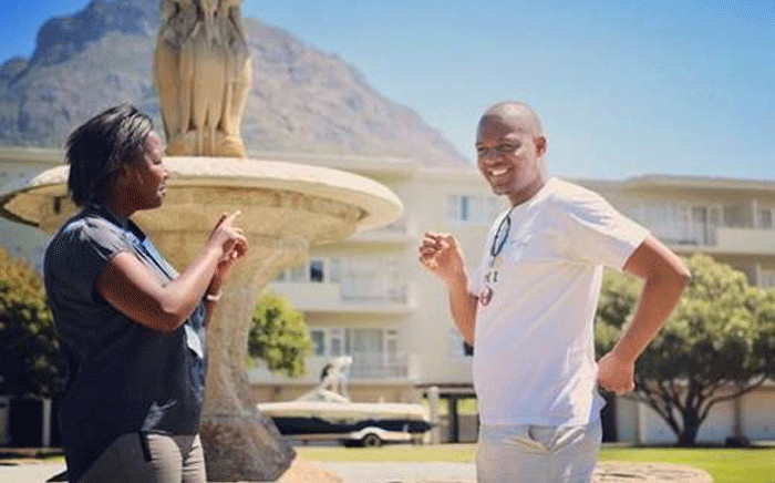 UCT's Qobo Ningiza (right) on campus with sign language interpreter Tshepiso Mokoena. Picture: Merlin Ince/Supplied.