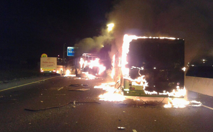 Traffic was brought to a standstill after two buses were torched following protests on the N2 highway near Cape Town Airport on 29 June 2016. Picture: EWN.