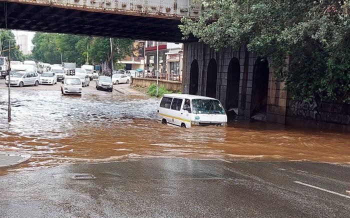 The railway bridge along Joe Slovo Drive & Siemert Street is flooded after heavy rain. Picture: @JoburgMPD/Twitter