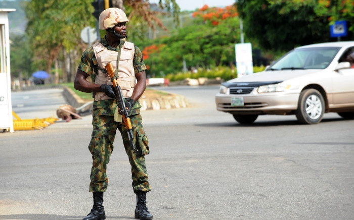 A soldier takes position in Abuja on 6 May 2014. Picture: AFP.