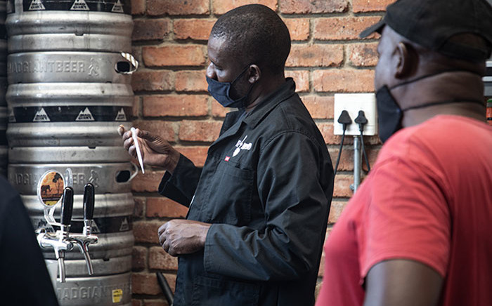 FILE: Following the strict lockdown regulations currently in place in South Africa, many breweries and micro-brewers are struggling to keep their doors open. Owner of Just Brewing Co. Julian Pienaar had to close a restaurant he co-owned and let some of his staff go, but managed to keep three out of his eight employees, including the chef who now works in his brewery. Picture: Xanderleigh Dookey-Makhaza