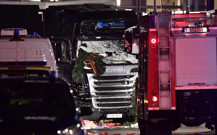The broken front window is pictured of the truck that sped into a Christmas market in Berlin, on 19 December 2016. Picture: AFP.