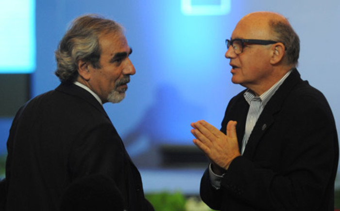 Uruguay's Vice Foreign Minister Luis Porto (L) speaks with Argentine Foreign minister, Hector Marcos Timerman (R) during a plenary session at the World Trade Organisation (WTO) conference in Nusa Dua, on the Indonesian resort island of Bali on 5 December, 2013. Picture: AFP