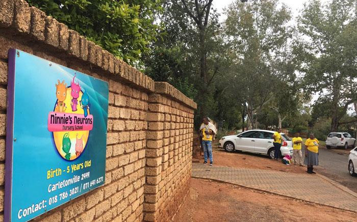 FILE: Parents gathered outside the Ninnie's Neurons Nursery School where a teacher was filmed beating children. Picture: EWN