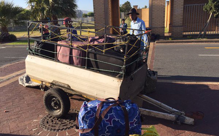 The last of several students wait on transport after being told to vacate their residences at the CPUT amid students protests. Picture: Natalie Malgas/EWN.