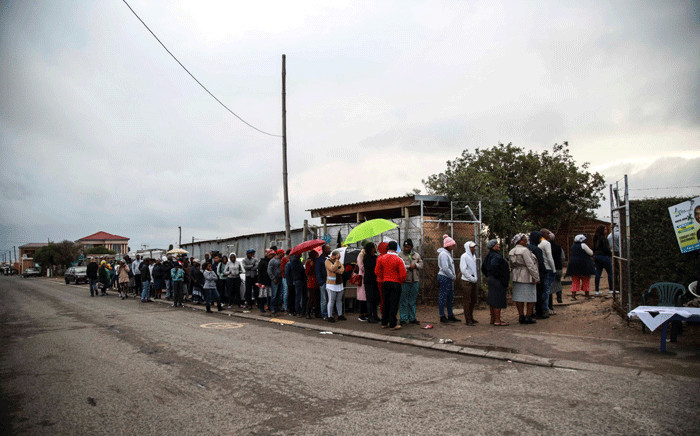 People queue to cast their votes at the Emfundisweni Pre-Primary School in Nomzamo, in the Western Cape. Picture: Cindy Archillies/EWN.