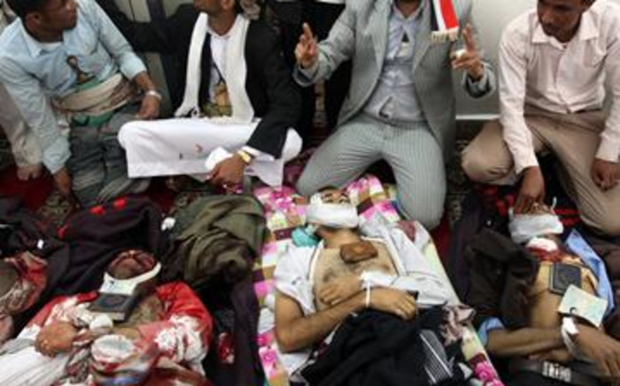 Yemeni men and medica prepare the bodies of protesters who were killed during an anti-government demonstration in Sanaa March 18, 2011. Picture: AFP