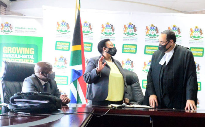 KwaZulu-Natal Premier Sihle Zikalala (left) watches as Nomusa Dube-Ncube (centre) is sworn in as Finance MEC on 17 November 2020. Picture: @kzngov/Twitter