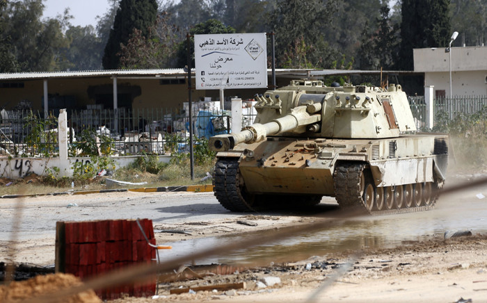 FILE: A tank belonging to Libyan fighters loyal to the Government of National Accord (GNA) is pictured during clashes with forces loyal to strongman Khalifa Haftar south of the capital Tripoli's suburb of Ain Zara, on 20 April 2019. Picture: AFP