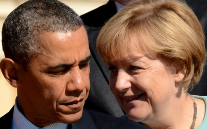 FILE: US President Barack Obama with Germany's Chancellor Angela Merkel during the family picture of the G20 summit in Saint Petersburg, on 23 October 2013. Picture: AFP