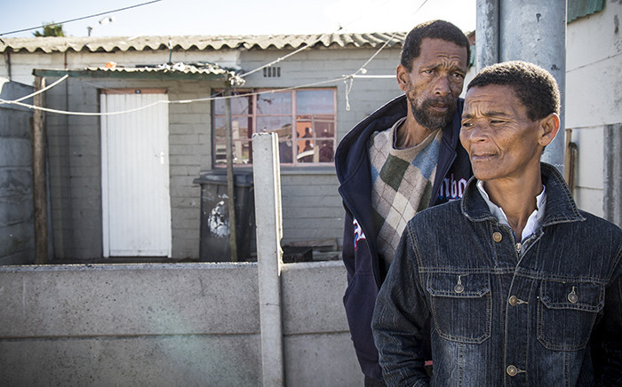 Parents of the missing 6-year-old Sandra and Calvin outside their home in Hanover Park, Cape Town. Picture: Thomas Holder/EWN